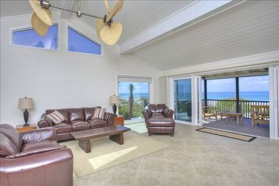 spectacular great room with entertainment center and open kitchen