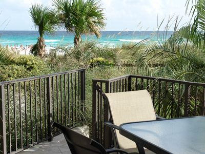 Beach view from patio. Grass yard, dunes, beach and pool only steps away.