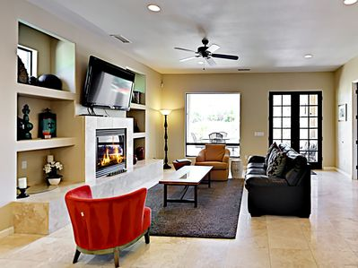 Living Room - Unwind in the upscale living room while watching a movie or enjoying a book by the fireplace.