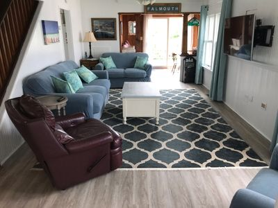 Recently Renovated Living Room with TV and Ceiling Fan