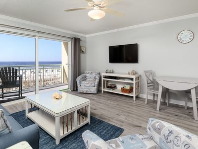 Photo for Pelican Isle 202:**MUST SEE** Remarkable beach front unit. WiFi,Pool, Hot tub