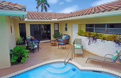 Photo for Three Bedroom Home In Paradise, Steps From The Beach And Town, Heated Pool