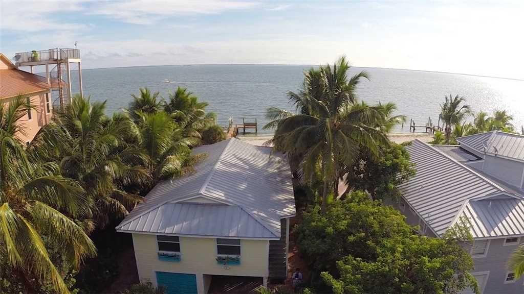 FABULOUS 2 BEDROOM 2 BATH BAYFRONT HOME WITH PRIVATE FISHING DOCK