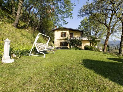 Photo for Villa apartment, immersed in a green landscape, featuring a terrace with an unequalled lake view