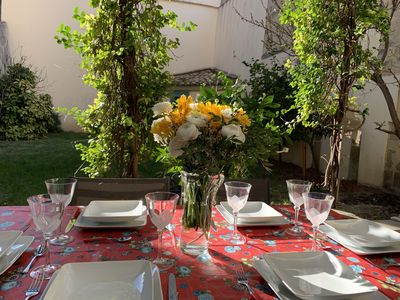 Photo for Beautiful air-conditioned apartment with garden Place de la Canourgue