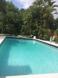 Photo for Beautiful Pool House 2 bedrooms/2 bathrooms w tropical garden to enjoy outside.