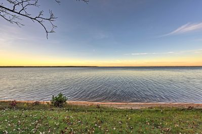 This quaint, Pelican Lake home provides an excellent sunset viewing point.