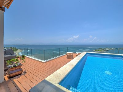 Photo for Luxurious beachfront penthouse! Panoramic views, white sand beach, private pool