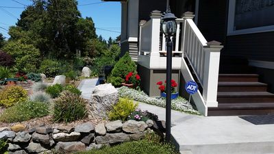 Walkway around the front of the house leads to private side entrance