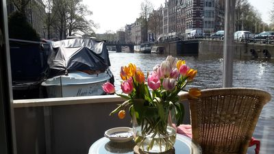 Pantheos Houseboat in Prinsengracht  with a view of the Westerkerk the Landmark.