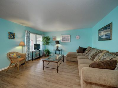 The living room offers plenty of space to relax and watch your favorite show or sports programs.