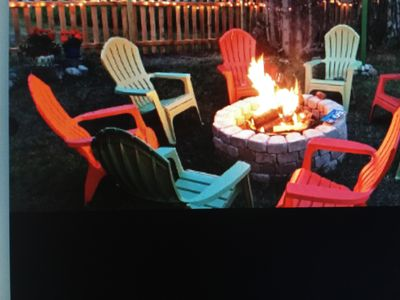 Relaxing by the firepit in the privacy of your own fenced in back yard.