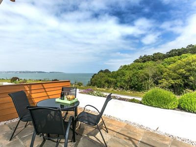 Photo for Sandpiper 3 The Cove - front row sea views, large terrace, swimming pool, parking & Wi-Fi