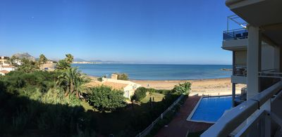 Photo for Beautiful apartment on the beach with sweeping balcony views and a large pool.