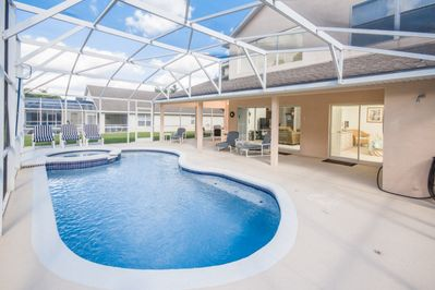 Tropical Pool Area with 14' x 28' Swimming Pool, a Raised Deck Area with Spa, and Oversized Covered