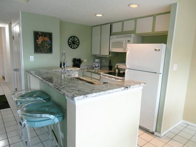 Fully equipped kitchen. Kitchen island seats 2 and dining table for 4.