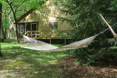 Enjoy a lazy afternoon in the hammock under the trees