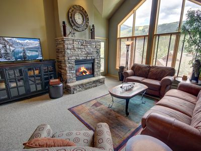 Photo for Bring your extended family or group of friends to this 4 bedroom condo for your mountain stay! This condo will be perfect for your group with vaulted ceilings and great views of Keystone's slopes. Relax in the comfy living room furniture in front of the ga