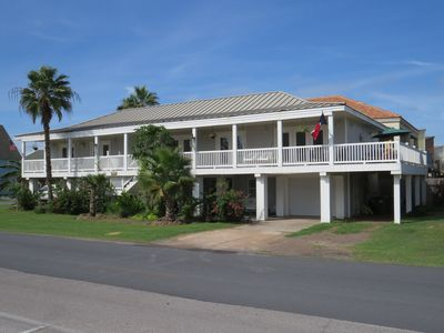 Key West style beach house.  Upstairs unit begins right of stairway.