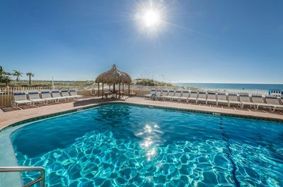 Heated swimming pool faces the beach
