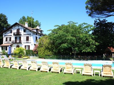 Photo for Luxury manor with heated outdoor pool, tennis court & 5 minutes from the beach