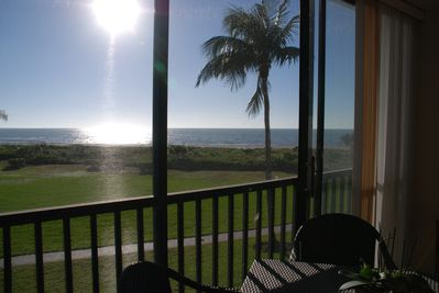 Gulf view from the screened lanai  with sliding glass doors & vertical blinds