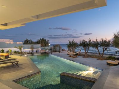 Photo for Sea front 10 bedroom villa with infinity pool and spa in southeast Crete
