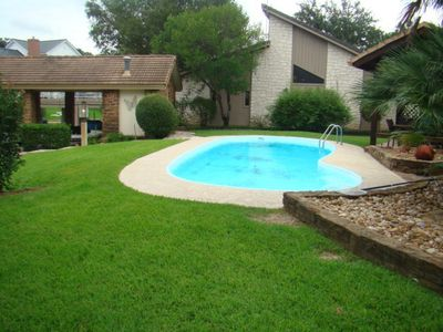 Photo for Spacious house with pool and boat lift right on channel!!