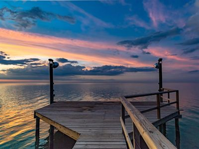Photo for Beautiful Bayfront home located on Copano Bay with a private fishing pier and picturesque sunsets!