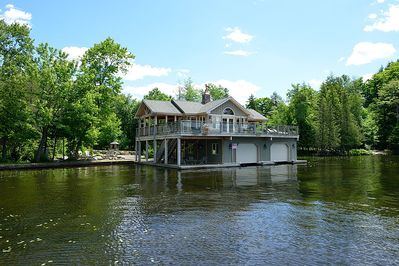 2-slip boathouse with 1-bedroom, kitchen, living room, bathroom, outdoor bar...