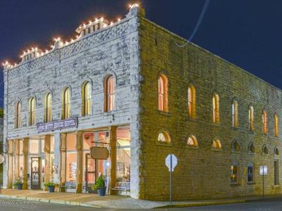 Photo for Stay of a lifetime with your group! Rent a whole hotel ON the Granbury Square!