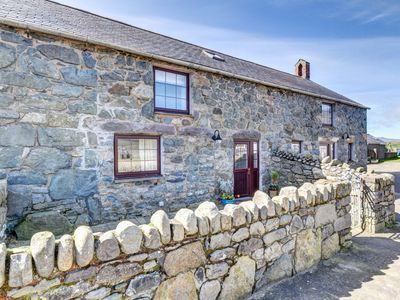 Photo for This five star cottage, situated just half a mile from the beautiful beach of Porth Neigwl, is the p