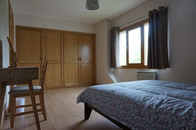 Fitted wardrobe including drawers and long mirror. standard double bed.