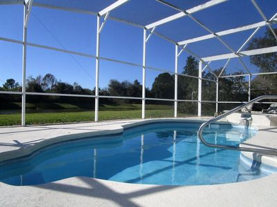 Photo for 'Lakeside Haven'  Fantastic South Facing Pool, Spa and Stunning Lakeside Views.
