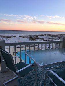 Sunset on our deck overlooking the pool and ocean!