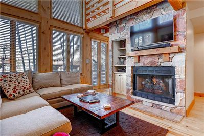 Relaxing living room cozy gas fireplace large screen TV - Park City Lodging-Portico 7