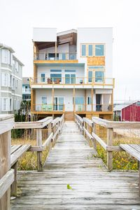 House from the beach side. You will be renting the top two floors.