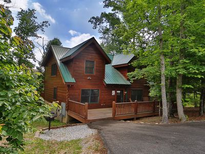 Photo for Adorable cabin tucked in the woods is ideal for a small family or a couple of friends to enjoy.