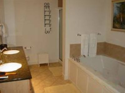 Jetted tub and shower in master bathroom.