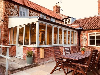 Photo for Half Moon House is  a beautifully renovated Norfolk brick and flint cottage
