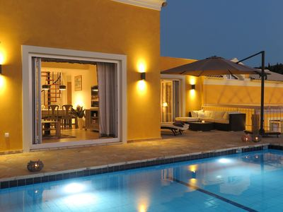 Photo for Luxury villa with private swimming pool overlooking the sea and sunset