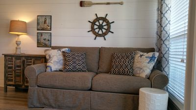 Nautical décor and a La-z-Boy sofa in the living room.