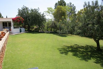 ONE OF THE BEAUTIFUL GARDENS LEADING OFF OF POOL & TERRACES