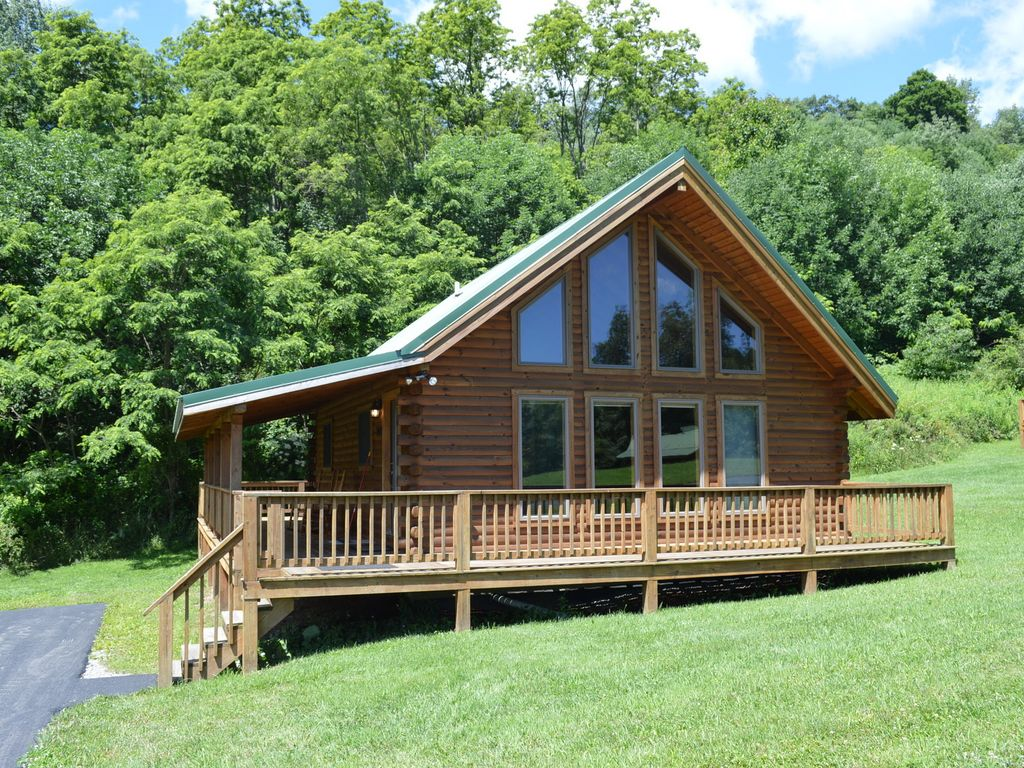hotels vacation property area on west image wv s ha cabins luxury yards back from beach deal bed deck conservation virginia with tub home in hot the