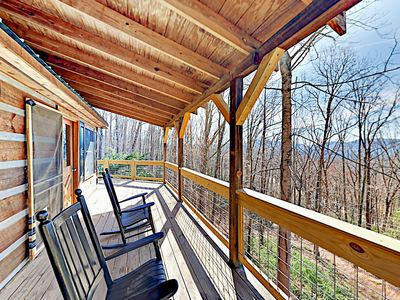 Photo for Secluded Log Cabin w/ Waterfall, Stone Fireplace & Mountain-View  Deck
