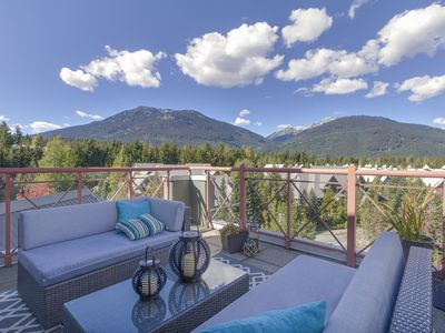 Photo for Newly renovated condo with 180 views of Whistler plus pool, hot tub, gym & sauna