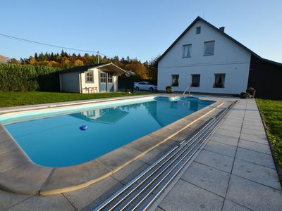 Photo for Comfortable apartment with covered pool and fenced garden