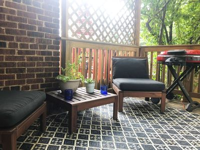 Back deck off breakfast room with seating and grill