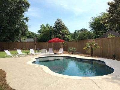 7 poolside lounge chairs w/ umbrella and gas fire pit