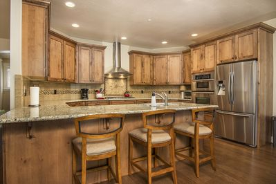 Gourmet spacious kitchen, granite counters, stainless top of the line appliances